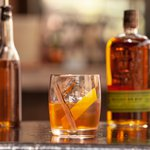 A glass of neat Bulleit Bourbon. Click to find our recipe for neat bourbon