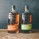 A bottle of Bulleit® Bourbon next to a bottle of Bulleit® Rye