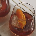A glass of Old Fashioned cocktail. Click to find our recipe for an Old Fashioned