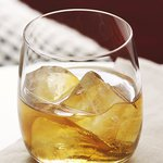A glass of Bulleit Bourbon on the rocks. Click to find our recipe for bourbon on the rocks